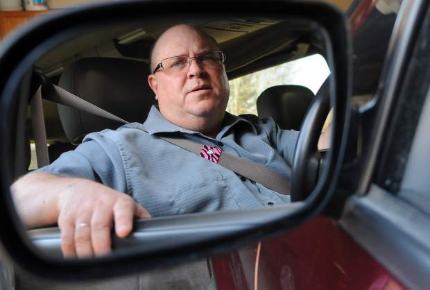 JOSHUA POLSON/jpolson@greeleytribune.com Tad Johnson sits in his car Thursday morning at his home in Loveland with a piece of brightly colored ribbon around his seatbelt as a reminder of his daughter, Alexa Johnson, who died in February after rolling her pickup. The ribbons, called Alexa's Hugs, were made by the Johnson family to remind people to wear their seatbelt.